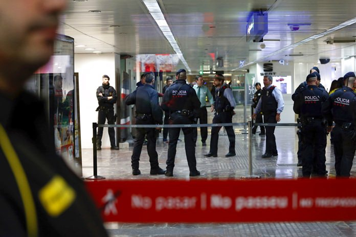 Regional police in Catalonia cordon off one of the entrances at the city's main train station in Barcelona, Spain, Wednesday, Nov. 7. (AP Photo/Joan Monfort)
