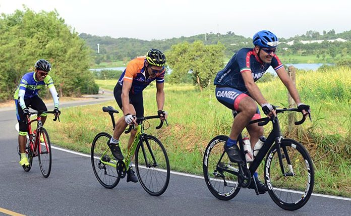 Cyclists compete in the male Open category over a 62km scenic course around Siam Country Club.