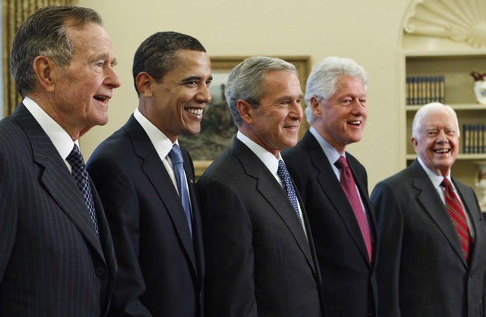 In this Jan. 7, 2009, file photo, President George W. Bush, center, poses with President-elect Barack Obama, second left, and former presidents, George H.W. Bush, left, Bill Clinton, second right, and Jimmy Carter, right, in the Oval Office of the White House in Washington. (AP Photo/J. Scott Applewhite, File)