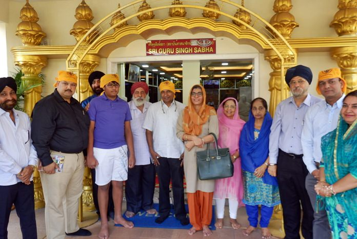 H.E. Mrs. Suchitra Durai and her husband former ambassador R. Swaminathan pose for a photo in front of the Sri Guru Singh Sabha Sikh Temple.