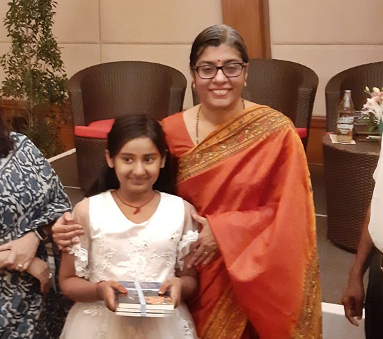 The ambassador presents books of learning to a very talented India student.