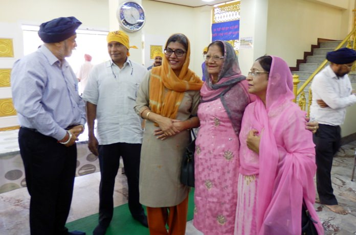 The ambassadors are greeted by the Sikh elders.