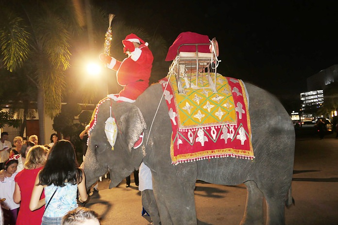 "Santa arrived on the back of an elephant to hand out gifts to deserving children who appeared on the ""nice"" list at the Thai Garden Resort."