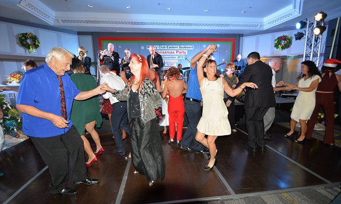 Rotarians and community activists dance to the sounds of B2F during the Rotary Club of the Eastern Seaboard's annual holiday party.