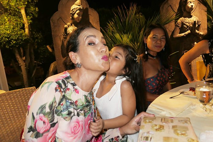 Anselma Niehaus receives a Christmas kiss from a beautiful little angel at the Thai Garden Resort.