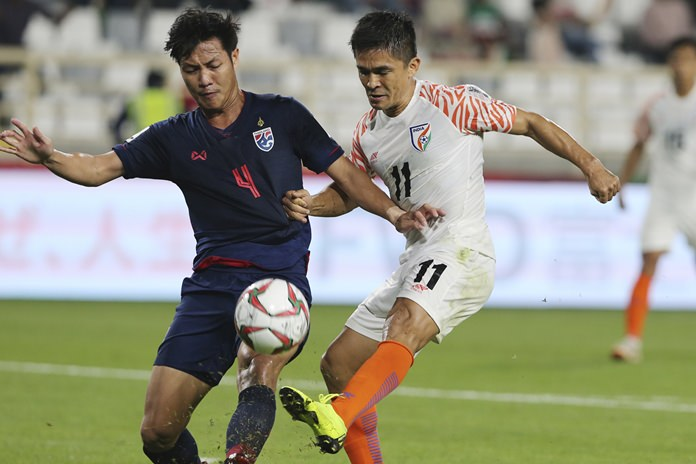 Thailand's Chalermpong Kerdka fights for the ball with India's Sunil Chhetri during their teams' AFC Asian Cup group A match in Abu Dhabi UAE Sunday Jan. 6