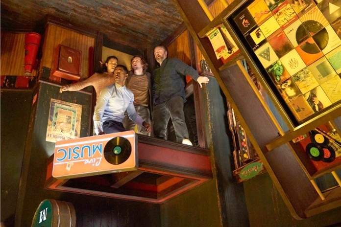 "This image released by Sony Pictures shows Jay Ellis, Taylor Russell, Logan Miller and Tyler Labine in ""Escape Room."" (David Bloom/Sony Pictures via AP)"