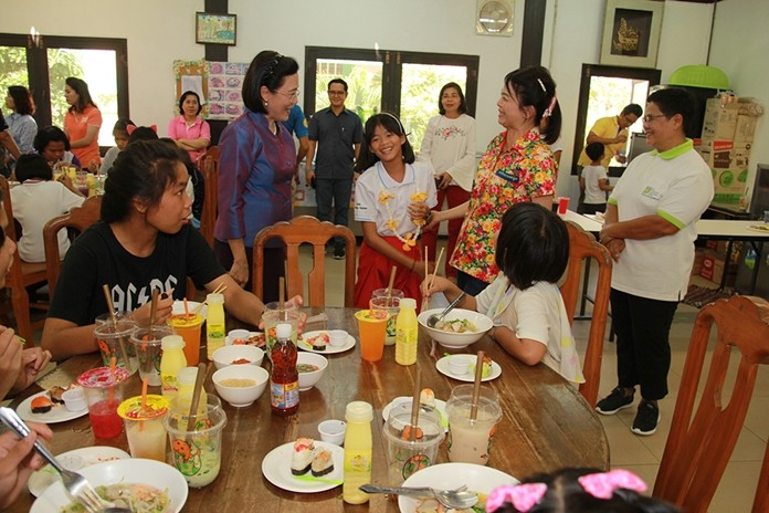 Radchada Chomjinda and children welcome Supaporn Thienchai to the Children's Day party at the Child Protection and Development Center.