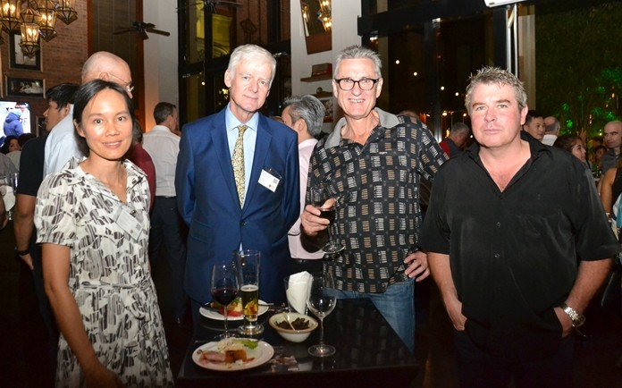 Rugby School Thailand's Business Development Manager Punsiya Jitkasemsopon and Director of Admissions Ashley Deacon chat with Delta Hydraulics (Thailand) CEO Jason Bresnehan and Technical Services Administrator Nigel Harris.