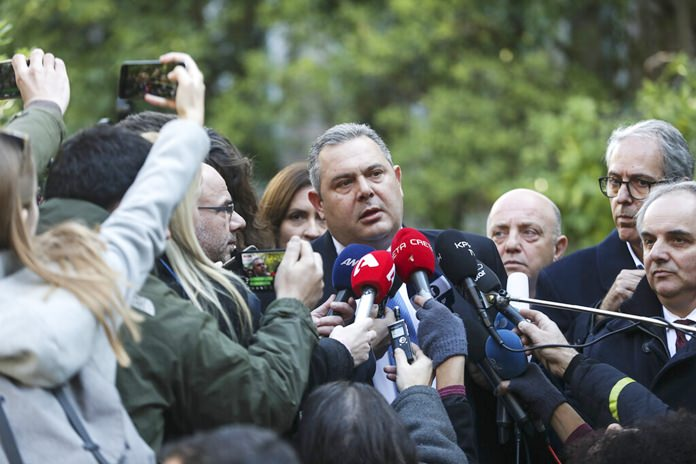 Greek Defense Minister Panos Kammenos, center, makes a statement to the media following a meeting with Greece's Prime Minister Alexis Tsipras, in Athens, Sunday, Jan. 13. (AP Photo/Yorgos Karahalis)