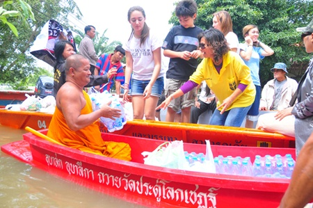 Regent's students and parents provide aid to the local temple to distribute.