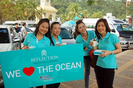 "Staff from sponsor Reflection Condo enjoy breakfast while prepping signs for the Festival's ""Save the Ocean"" theme."