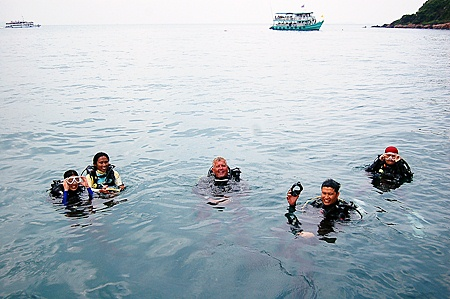 Aquanauts Dive Centre instructor Gary Gwilliam, center, waits with his charges to begin the underwater treasure hunt.