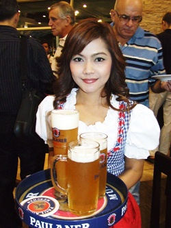A lovely Kellnerin serves up ample amounts of Paulaner beer.