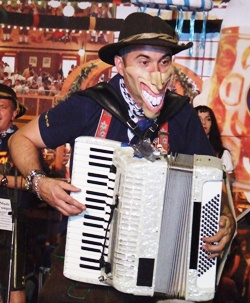 """""""Smiley"""" rips through the chords on his accordion."""