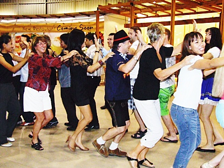 Guests join up for a traditional polonaise dance.