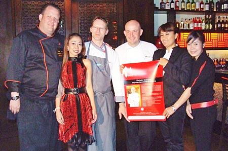 Friends welcome Michelin star chef, Thomas Kammeier (center) to Mantra Bar & Restaurant.