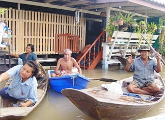 With their homes inundated, people need to use boats instead of cars.