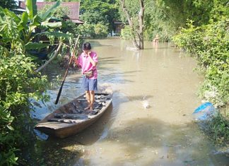 Area residents have been chipping in money and supplies to help flood victims throughout the kingdom where, in many areas like this one in Ayutthaya, the only way to get around is by boat.
