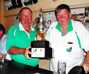 The Beaver team captains, Larry and Dennis Willett, pose with the annual challenge trophy.