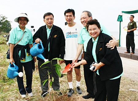 """Chatchawal Supachayanont (2nd right), general manager of Dusit Thani Pattaya is seen with Dr. Jiraphol Sindhunava (middle), vice-president of the Green Leaf Foundation and other officials after planting a young tree during the """"We Care for Trees"""" campaign."""