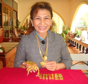 Nittaya Patimasongkroh, owner of Trathong gold shop, says gold prices are at record highs.