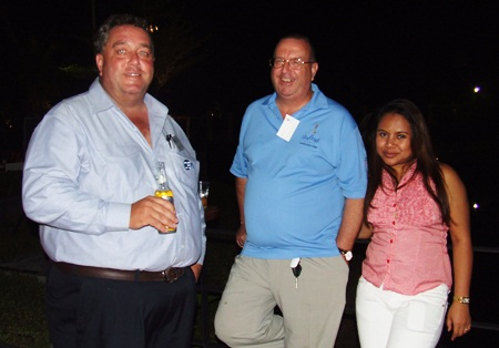 (L to R) Kevin Fisher, manager of the Far East Region of Cranes and Equipment Ltd.; John Clarke, chief executive officer of Forbears Freedom Wealth Management Co., Ltd.; and Miss Rujira Phatham.