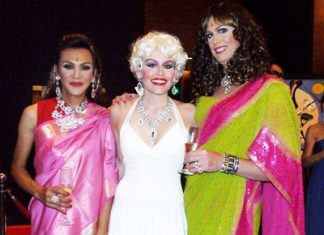 Marilyn Monroe strikes a pose with two exotic maharanis.