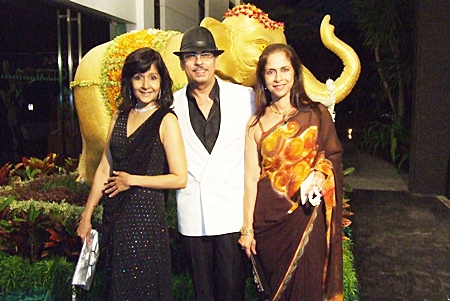 Jack & Av from Indian by Nature restaurant pose with PMTV's Sue K, left.
