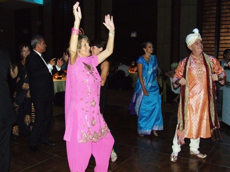 Party goers show off their costumes on the dance floor.