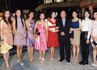 General Manager Chatchawal Supachayanont with guests at the Dusit Thani's 1960s-theme open house party.