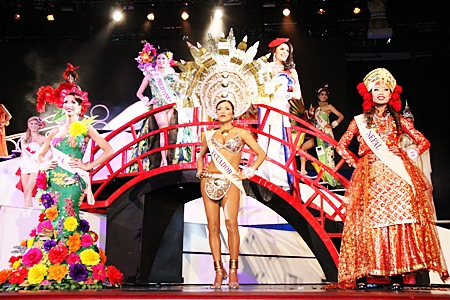 Contestants show off their fabulous national dresses.