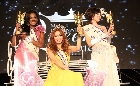 (L to R) 2nd runner up Stasha Sanchez from USA; winner Minnie Han; and 1st runner up Ami Takeuchi from Japan ecstatically show off their newly won trophies.