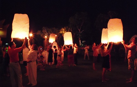 Guests at the Centara Grand Mirage Beach Resort light their khomloys and prepare to send them skyward, taking away bad luck for the coming year.