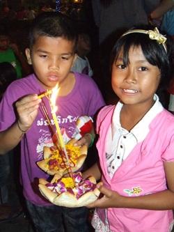 Children float their 'bread' krathongs.