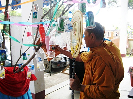 A monk leads the 'tod pha pa' recycling merit making ceremony at Wat Raj Samakee in Sattahip.