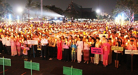 Thousands of people dressed in pink light candles and show their love for His Majesty King Bhumibol Adulyadej.