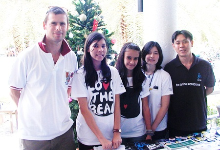 Louis with teacher Paul Crouch and students of the Round Square project, Regents School, Pattaya, who organised Louis's trip to Thailand.