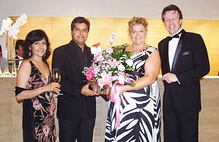 Sue Kukarja, director of Pattaya Mail Television, and Tony Malhotra, director of Pattaya Mail Media Group, congratulate Peta Ruiter, director of business development, and Michel Sheffers, director of operations.