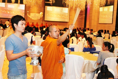 Harald Feurstein, general manager of Hilton Pattaya, led staff in performing a Buddhist merit-making ceremony with nine monks blessing the hotel and its staff.