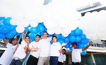 2010 blue and white balloons are released into the sky.