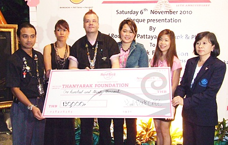 (L to R) Roland Nicholich, assistant general manager of Hard Rock Cafe Phuket; Panta Cheidech. director of sales and marketing for Hard Rock Cafe Phuket; Matthew Carlos, manager of the Hard Rock Cafe Pattaya; Sita Vonkhoporn, PR & marketing for Hard Rock Cafe Bangkok; Nualprang Varongkriengkrai, sales & marketing for Hard Rock Cafe Bangkok; and Manussawad Kesboonchu, manager of the Thanyarak Breast Cancer Foundation display the funds raised during the charity drive.