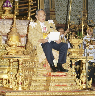 HM King Bhumibol Adulyadej reads a statement during a ceremony on his 82nd birthday celebration at the Borombhimarn Throne in Bangkok, Saturday, Dec. 5, 2009. On Wednesday, May 5, 2010, the Kingdom marked the 60th anniversary of the Coronation of His Majesty King Bhumibol Adulyadej the Great.