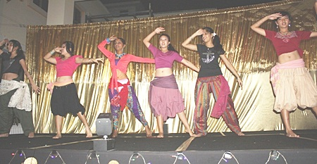 A group of secondary students keep the show going with their Indian modern dance.