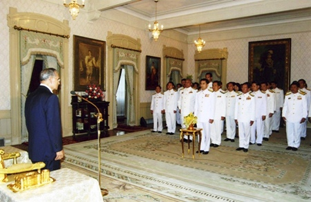 HM King Bhumibol Adulyadej calls for the new government to make peace its priority during a swearing-in ceremony at Chitralada Palace in Bangkok Monday, Dec. 22, 2008. Prime Minister Abhisit Vejjajiva, standing front row, and his cabinet members listen intently.