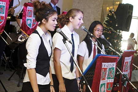 Lisa Durant, Valerie DeSaegher and Francis Calalang sing some Christmas classics with the Regent's School soul band.