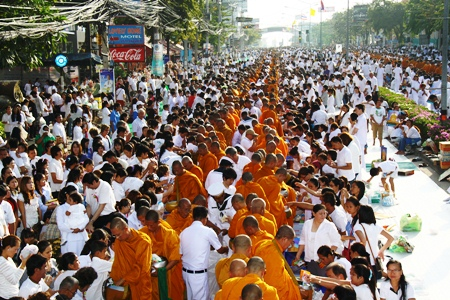Thousands of devout Buddhists and people of many faiths join in the merit making ceremonies along North Pattaya Road.