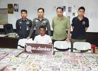 Pattaya Police Superintendent Nanthawut Suwanla-Ong (standing, center) has announced an aggressive crackdown on child pornography, which began with the arrest of Udon Dan-Ud.