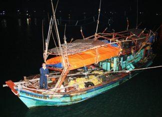 The Royal Thai Navy brings in a Vietnamese fishing boat caught illegally trawling near Sattahip.