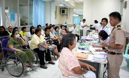 Cmdr. Yada Phucharoen (standing, 2nd right), chief of the Diabetic Clinic explains the procedure to folks about to receive the vaccination.